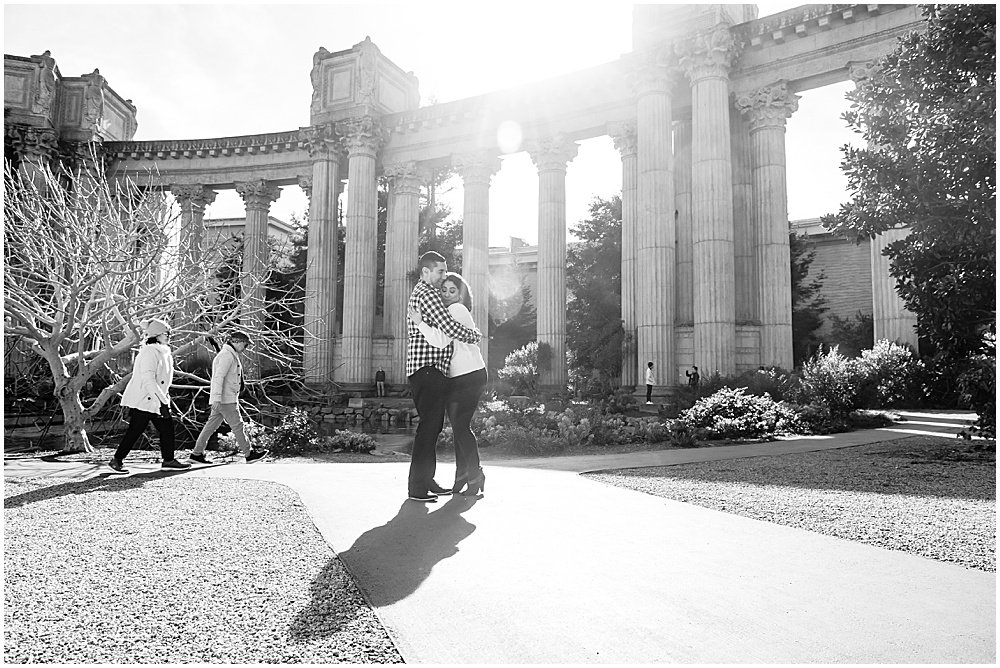 Black and white engagement photo at the Palace of fine Arts san Francisco