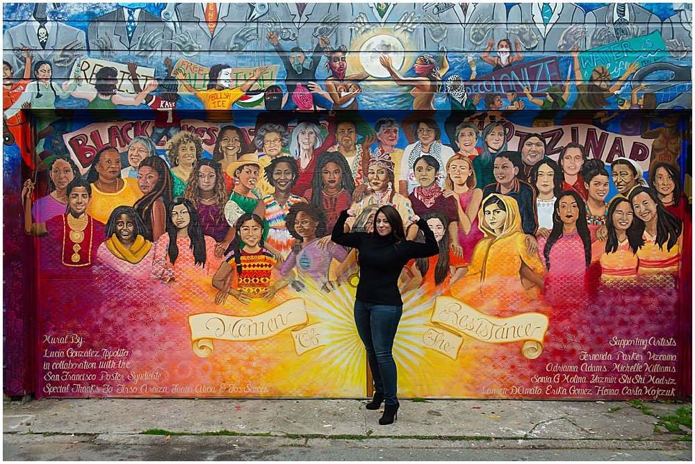 Woman in front of mural in San Francisco