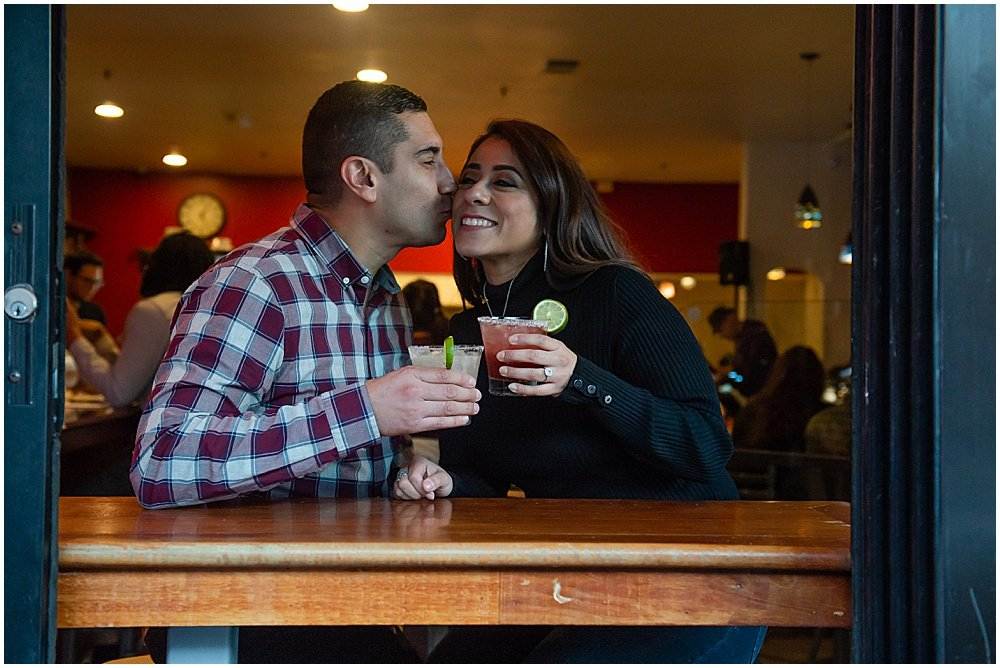 Cocktails and a kiss engagement photo in San Francisco
